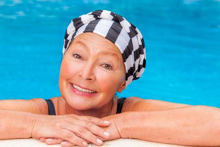 female senior workout smiling camera Stock Photo