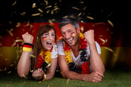 happy funny german couple rising arms photo