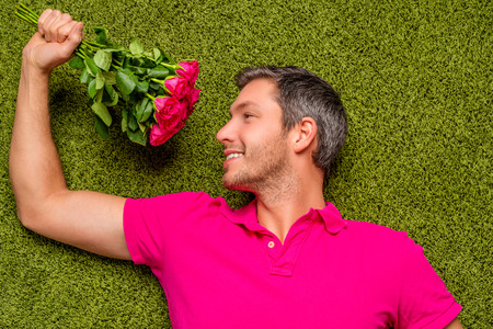 romntiv female lover holding bunch of flowers photo