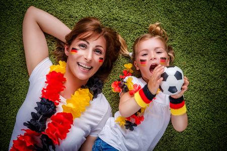 kibitz: mother child soccer fan