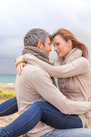 happy embracing lover couple on the beach photo