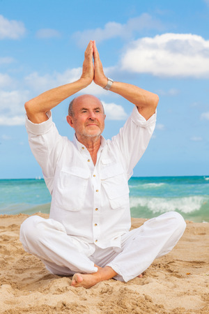 older man relaxing fitness balance  photo