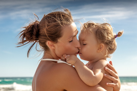 traveling family  female woman hugs baby on vacations Stock Photo