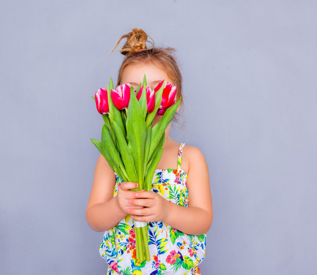 little cute holding bouquet as present for mother father day photo