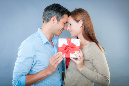 happy couple holding together a present