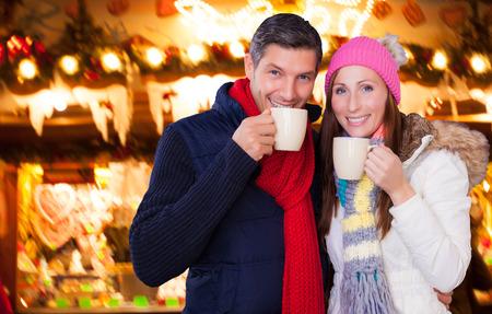 weihnachtsmarkt: german couple enjoying the christkindl outdoor