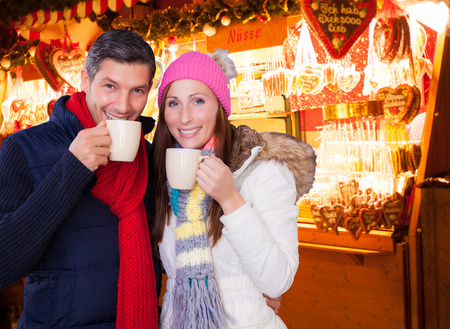 weihnachtsmarkt: german couple enjoying the christkindl outdoor