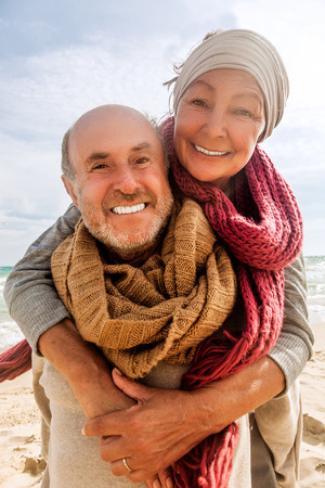 active: hug two beloved older people enjoying time Stock Photo