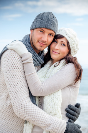 winter couple: happy lovely couple enjoying colder season