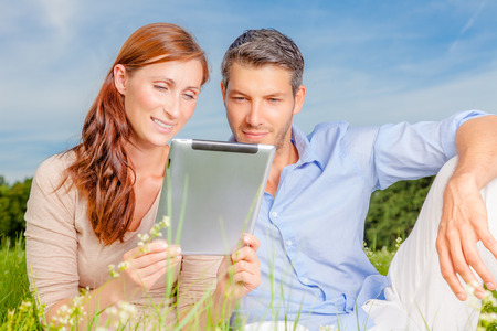looking for destination- couple with tablet photo