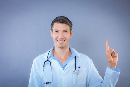 advise: medicale man showing finger for advise Stock Photo