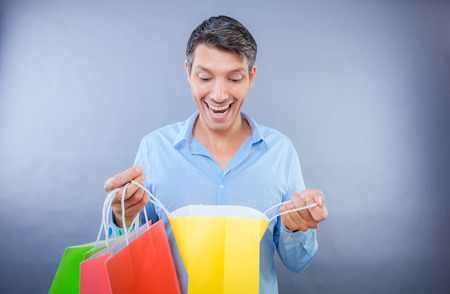 happy male laughing smiling shop surprise photo