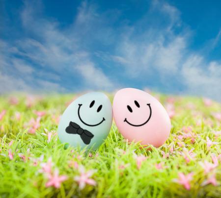 smiling ester eggs on green