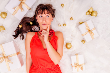gift background: thinking gifts online shopping girl