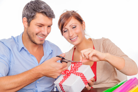 couple wrapping gifts at home photo