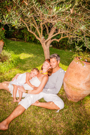family in home garden with child photo