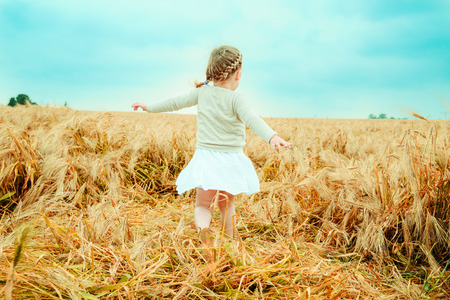 only 1 girl: dancing child nostalgic in field