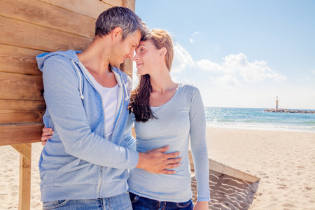 happy younger couple on coast