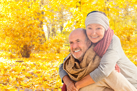 autumn in the park: happy autumn fall couple in leaves Stock Photo