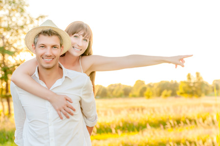 outstretched arms: happy couple with outstretched arms showing finger Stock Photo