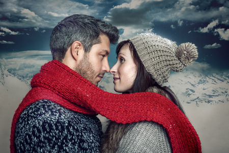 cold frosty two adult in front of dark sky Banco de Imagens