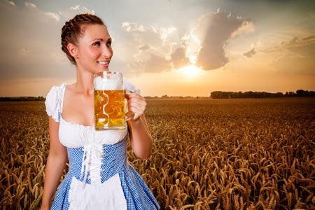 golden beer festival holding jar photo