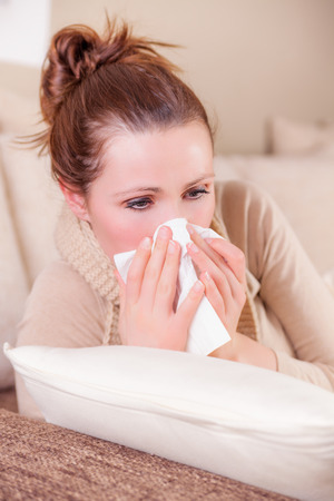 sick person: clwaning up nose feeling unwell Stock Photo