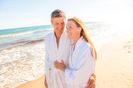 romantic couple: Spa couple relaxing while walking beach