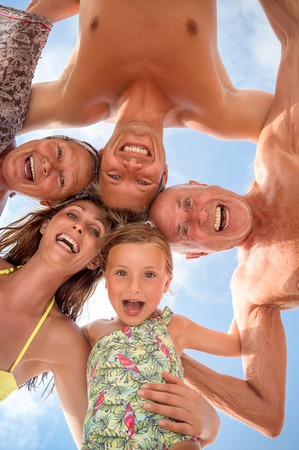 old people having fun: family memebers grand parents and younger Stock Photo