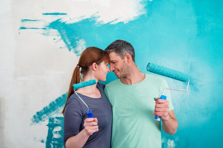 wall paintings: two head on head portrait with roller Stock Photo