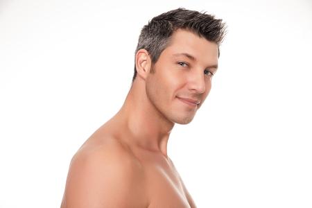 homme nu: sourire torse nu portrait homme isolé Banque d'images