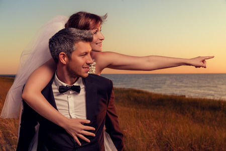 destination wedding: wedding couple outstretched finger showing destination