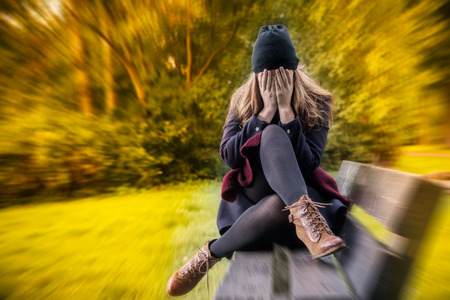 depressed female in autumn season Stock Photo