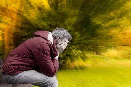 sad man in autumn season crisis Stock Photo