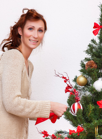 home decorating: decorating the xmas tree at home Stock Photo