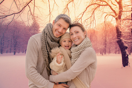 romantic kiss: family outdoors in winter landscape