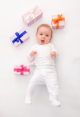 surprise box: funny cute little newborn with presents