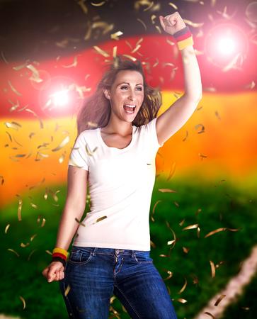 celebrating female: german flag winning celebrating female Stock Photo