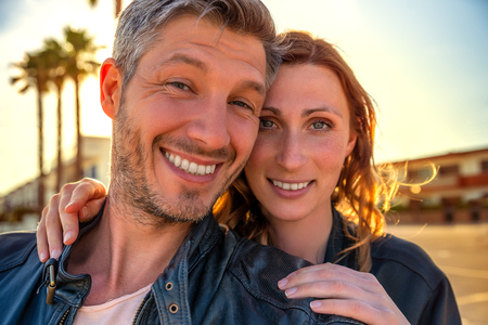 aged: miami couple smiling for selfie