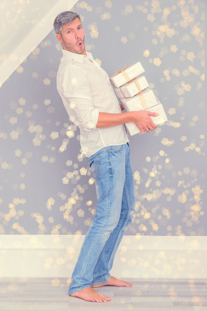 carries: carrying a lot of presents Stock Photo