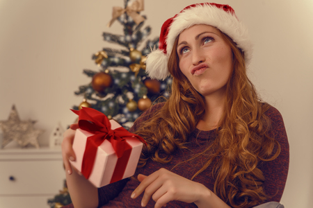 stock photo thinking what to give for christmas - What To Give For Christmas