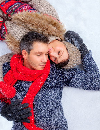 couple winter: snow winter lying couple together
