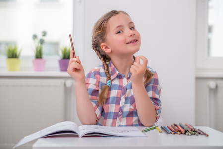little girl playing school at home