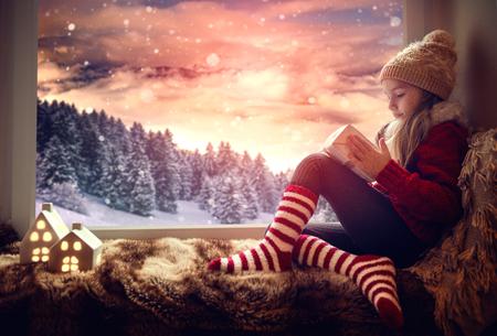little cute winter girl dreaming in winter landscape of christmas