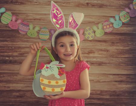girl holding easter basket with background Banco de Imagens