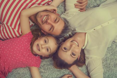 family lying on the woolen floor