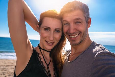 joyful couple looking camera doing selfie