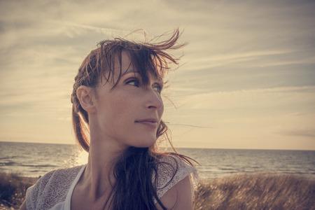 carefree woman looking the horizon