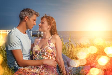 travel couple relaxing on the summer lake Banco de Imagens