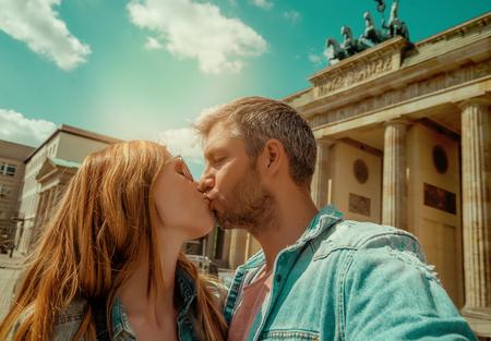 couple visiting berlin on brandenburger tor